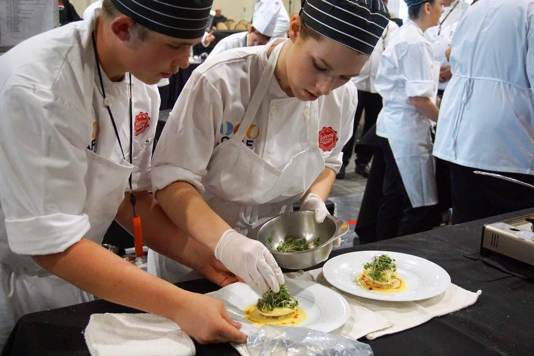 culinary students working on a dish