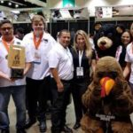 group of people at event and mascot