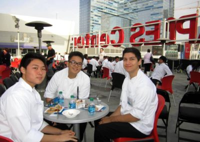 three guys sitting at table smiling